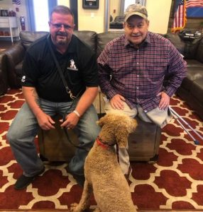 Service dog Lucky and his wounded veteran.